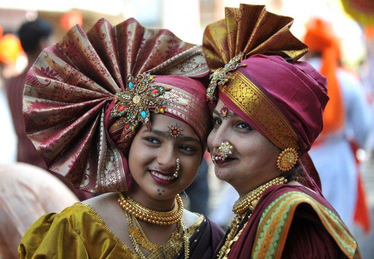 Maharashtrian women wearing tradition dress and jewellery.