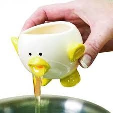 I found this egg separator so cute....it will separate the egg yolk in a jiffy without any hassles and is a great addition to kitchen