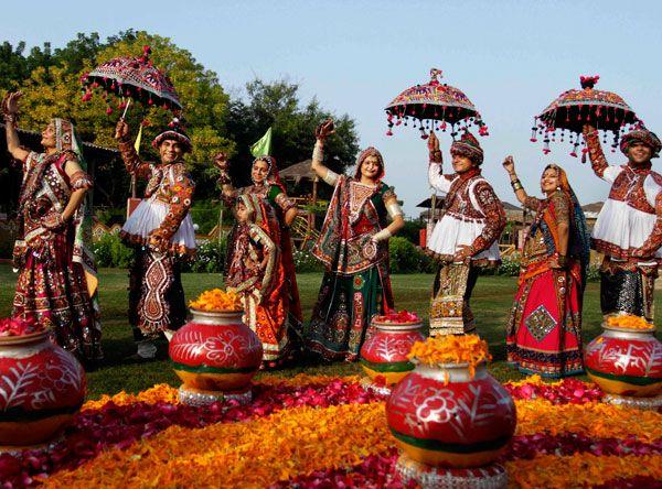Men and women performing Rajasthani folk dance.