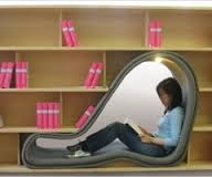 What an innovative book shelf! Who wouldn't like to sit in snugly with a good book? I am thinking of customizing this bookshelf for me.